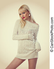 Beautiful blonde woman in knitted dress