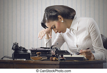 Stressed business woman - Depressed woman sitting at desk in...
