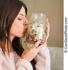 Woman Saves Money For The Future - Woman Saves Money And...