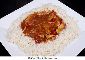 sweet and sour chicken with rice.
