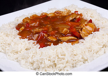 sweet and sour chicken with rice - Closeup photo of chinese...