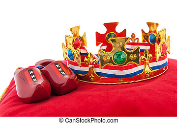 Golden crown on velvet pillow with Dutch flag - Golden crown...