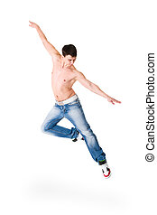 young handsome man in blue jeans jumping isolated on white...
