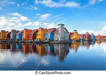 Reitdiephaven - colorful buildings on water in Groningen,...