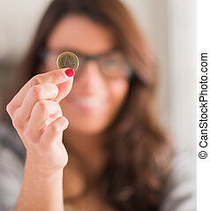 Happy Woman Holding Euro Coin, Indoors
