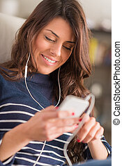Woman Listening To Music On Headphones - Happy Young Woman...