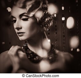 Toned portrait of elegant blond retro woman with beautiful...