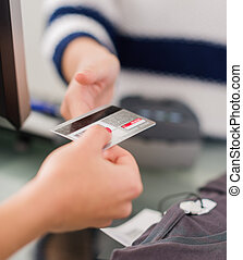 Woman Paying Bill With Credit Card - Close-up Of Woman's...