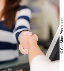 Two Women Shaking Hands - Close Up Of Two Women Shaking...