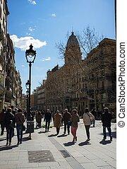 People walking on Avinguda del Portal de l'Angel in...