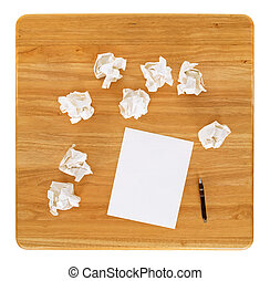 Creativity problems. Blank sheet of paper and crumpled paper...