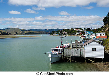 Motor boats and boat sheds at Paremata on Pauatahanui Inlet...