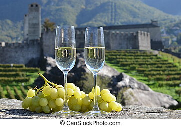 Pair of champagne glasses and grapes Bellinzona, Switzerland...