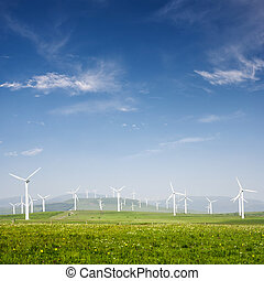 Wind power generation - Beautiful green meadow with Wind...