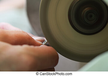 hands of jeweller at work. Silver polishing. - Closeup of...