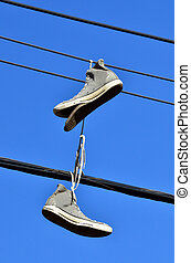 Old shoes - An old all star shoes hanged on electric line.