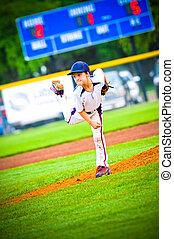 Little league baseball pitcher after a pitch