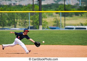Little league boy reach out to catch ball - Little league...