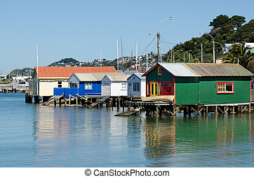 Wellington Cityscape - Old wooden boat houses in Wellington,...