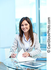 Friendly employer - Portrait of young female looking at...