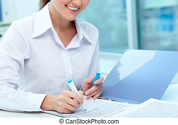 Recruitment test - Close-up of young female writing...
