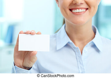 Contacts - Close-up of blank card shown by young smiling...
