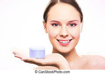 Source of skin nutrition - Fresh woman holding container...