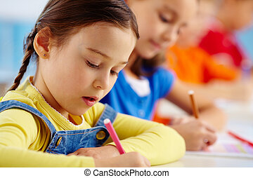 Drawing lesson - Portrait of lovely girl drawing at...