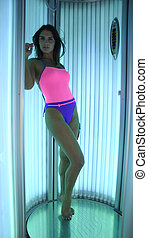 Young women in solarium - Beautiful happy young women in...