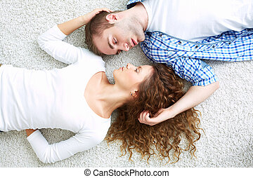 Lovers face to face - The above view of young lovers lying...