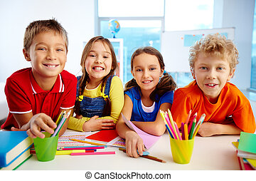 School friends - Portrait of smiling friends enjoying their...