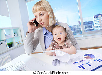 Working with baby - Portrait of successful businesswoman at...