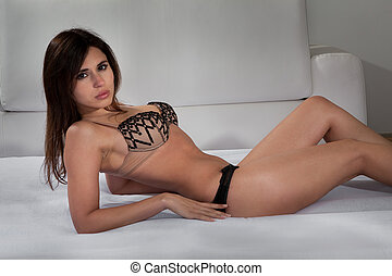 Young Woman In Lingerie Lying On Bed