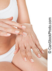 Woman Applying Cream To Her Hands