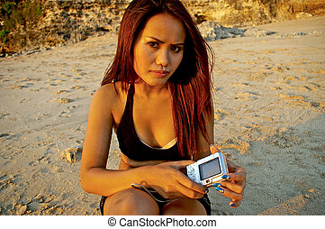 Asian woman with her camera - Beautiful Indonesian woman...