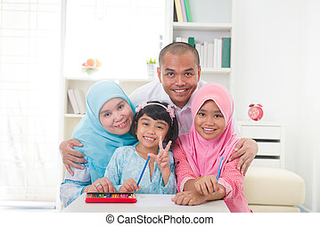 malaysian malay muslim family learning together with...