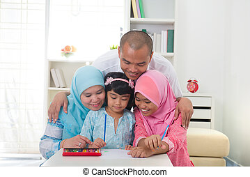 malaysian family doing homework together with lifestyle...