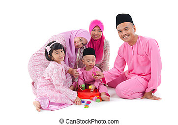 indonesian family having fun during hari raya