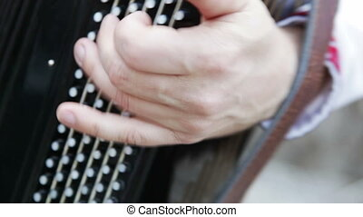 Playing on accordion - Playing the accordion. A street...