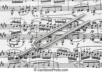 Pitchfork on sheet music - abstract art background