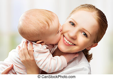 Happy cheerful family Mother and baby kissing, laughing and...