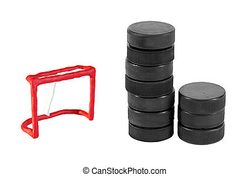 Hockey goal and a stack of washers - Toy plasticine hockey...