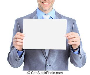 Nice businessman holds white poster Isolated on a white...