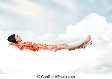 Girl on a cloud - Beautiful girl, sleeping on a white cloud