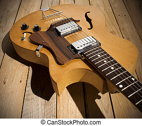 vintage jazz guitar on wooden floor