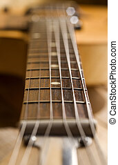 guitar fretboard with out of focus effect