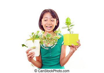 Smiling Asian girl with plants