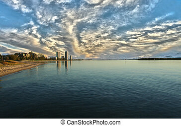 Runaway Bay Gold Coast - Apartment towers at sunrise at...