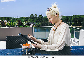 Woman surfing the net - Young woman surfing the net on...