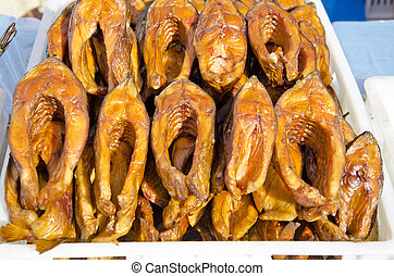smoked fish slices in market